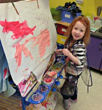 Kinder student creating a masterpiece