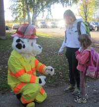 Sparky greeting two students